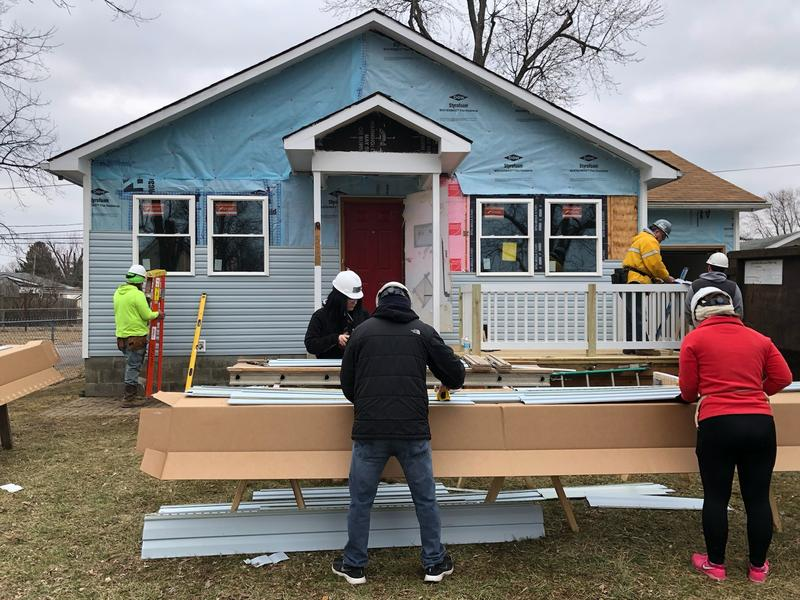 Columbus Gives Back volunteers work with Habitat for Humanity MidOhio on a project in Whitehall