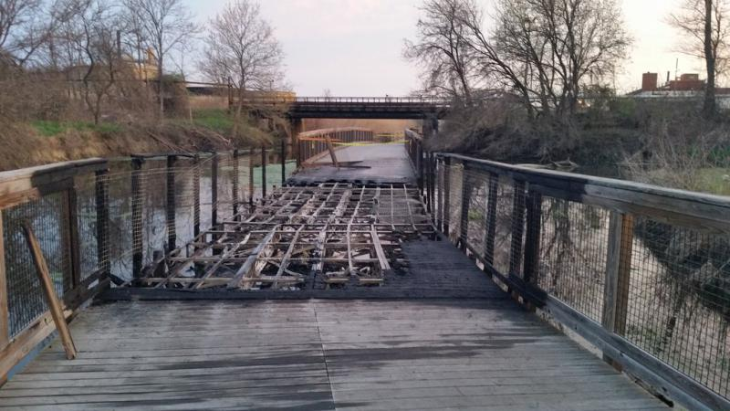 Photo of the vandalized Towpath Trail bridge near Akron