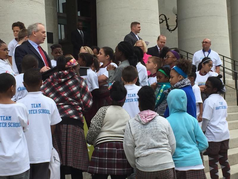 Students and supporters gather on the steps of the Ohio Statehouse to rally for charter schools