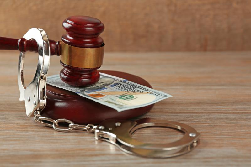 photo of gavel, money and handcuffs