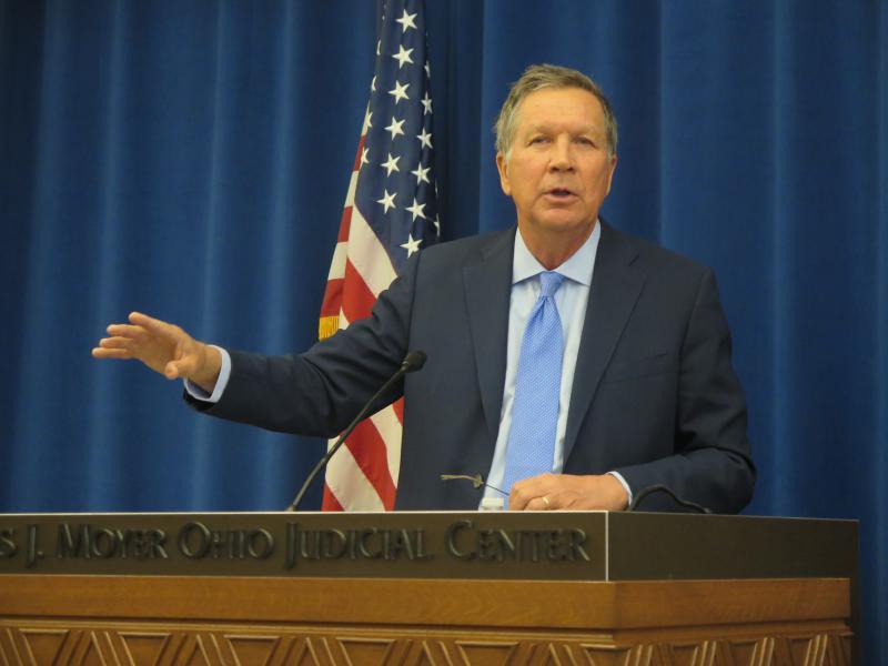 Governor John Kasich gestures at podium