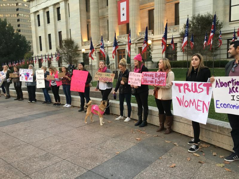 Planned Parenthood advocates holding signs