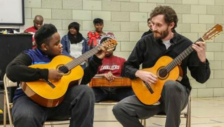 Damian Goggans (left) performs with Cleveland Classical Guitar Society director of education Brian Gaudino