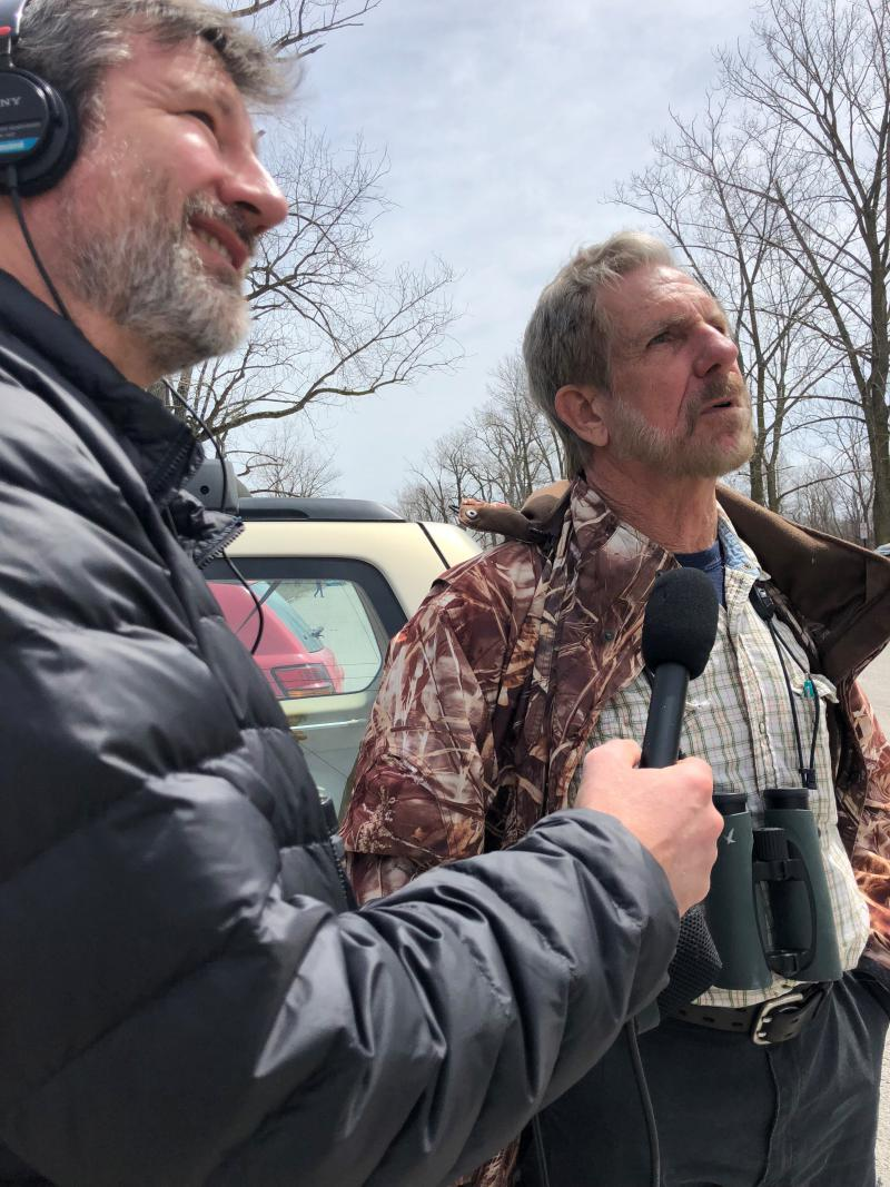 WKSU's Jeff St.Clair and birding author Kenn Kaufman spy a family of bald eagles, one of two nests at the parking lot near Magee Marsh Wildlife Area's boardwalk.