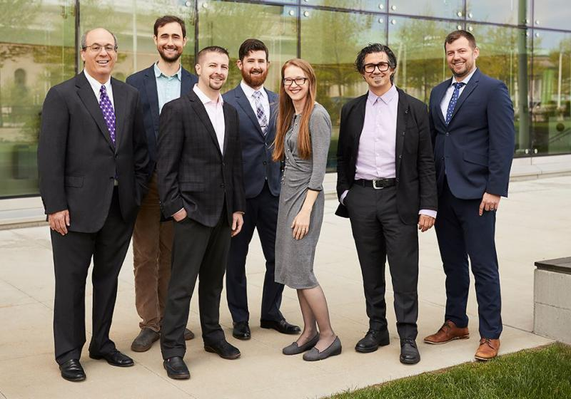 The management team at Convelo Therapeutics includes founding researchers Drew Adams, second from left, and to his left, Paul Tesar.  The company is developing small molecule therapeutics that,  in laboratory testing, stimulate myelin regeneration.