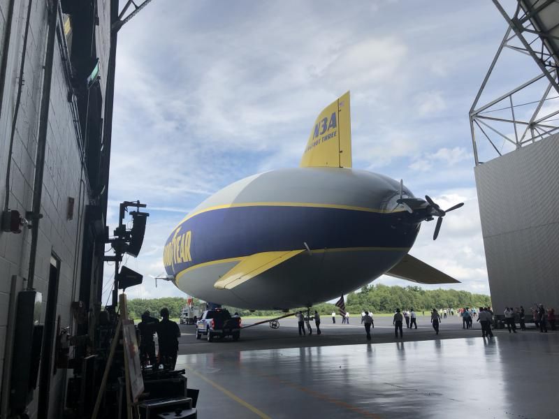 The Wingfoot Three makes its way out of the hangar for its christening flight.