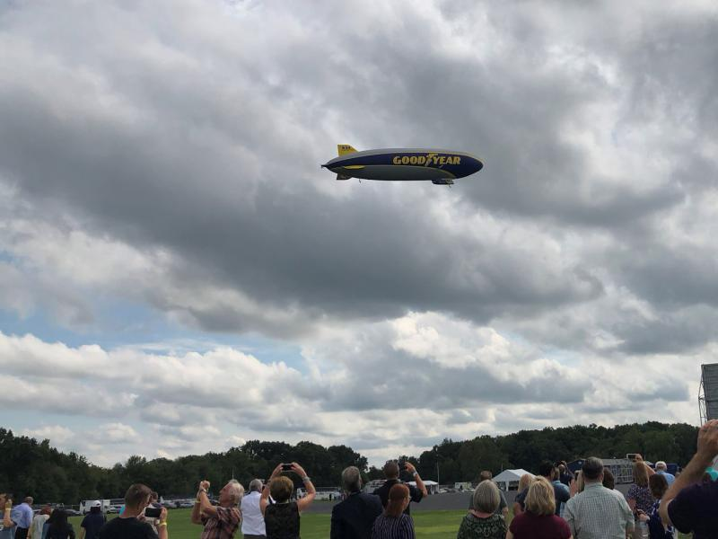 Goodyear's Wingfoot Three rises above the crowd.