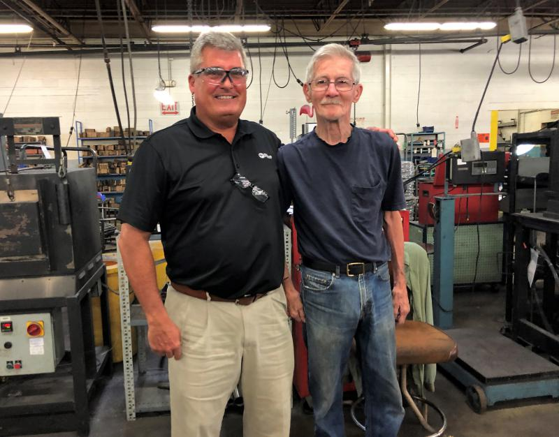 Dan Collins, left, is VP of marketing at Wire Products Company in Cleveland. Roger Wenmoth, right, at 80 years-old has been working on the same shop floor for more than 61 years.