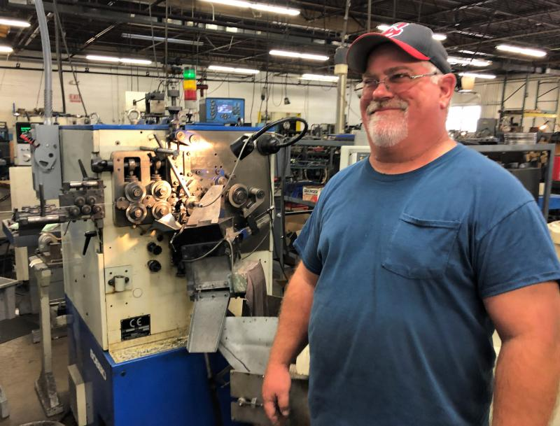 Dan Fullem operates equipment at Wire Products Company in Cleveland. The company is part of a research study led by Case Western Reserve University to help local manufacturers enter the Internet age.