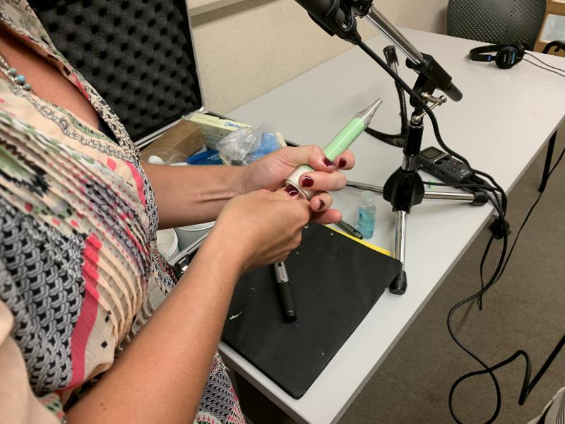 Malyuk gets ready to create a custom ear impression with silicone.