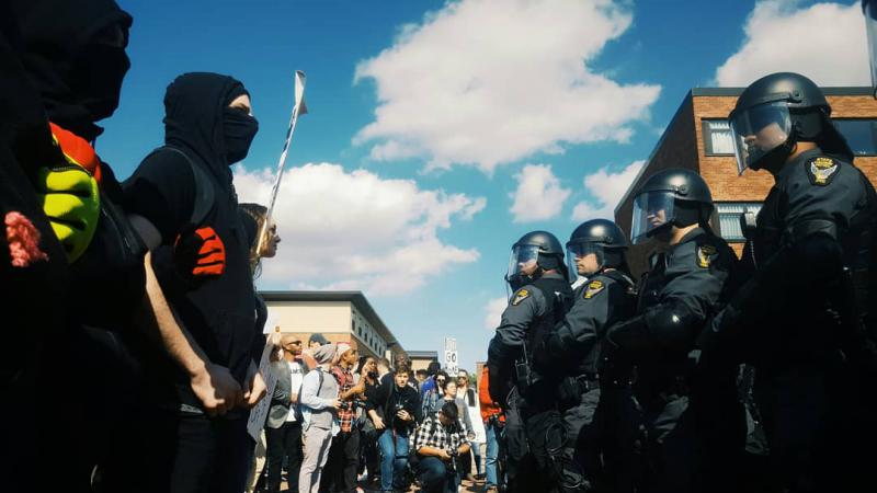 Photo of police standing off with protestors
