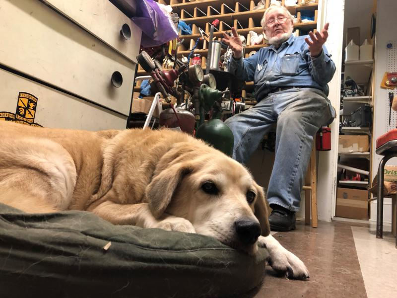 Sam, Don's yellow lab, joins him at work.