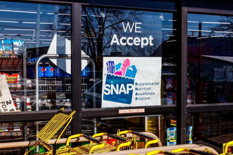 A photo of a SNAP benefit sign at grocery store.