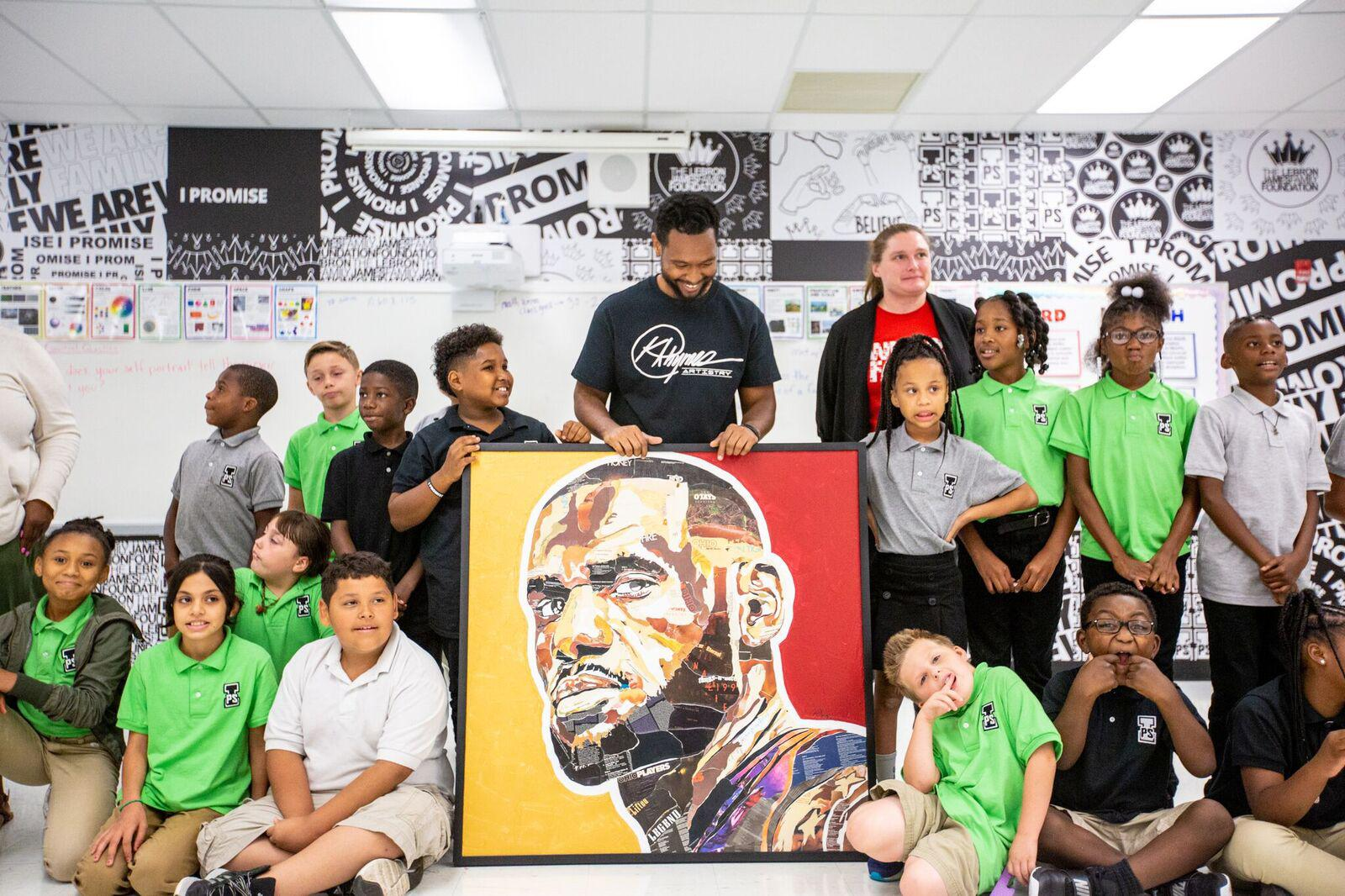 new concept c7a04 907f2 Artist Kris Rhymes with students from LeBron James  I Promise School. The LeBron  James Family Foundation says Rhymes donated this work to the school.