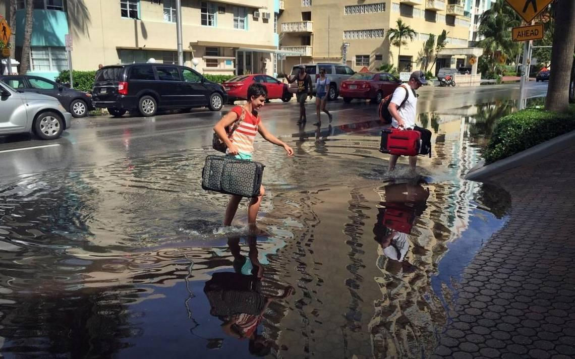 Oakley And Casey Jones Tourists From Idaho Falls Navigate The Flooded Streets Of Miami