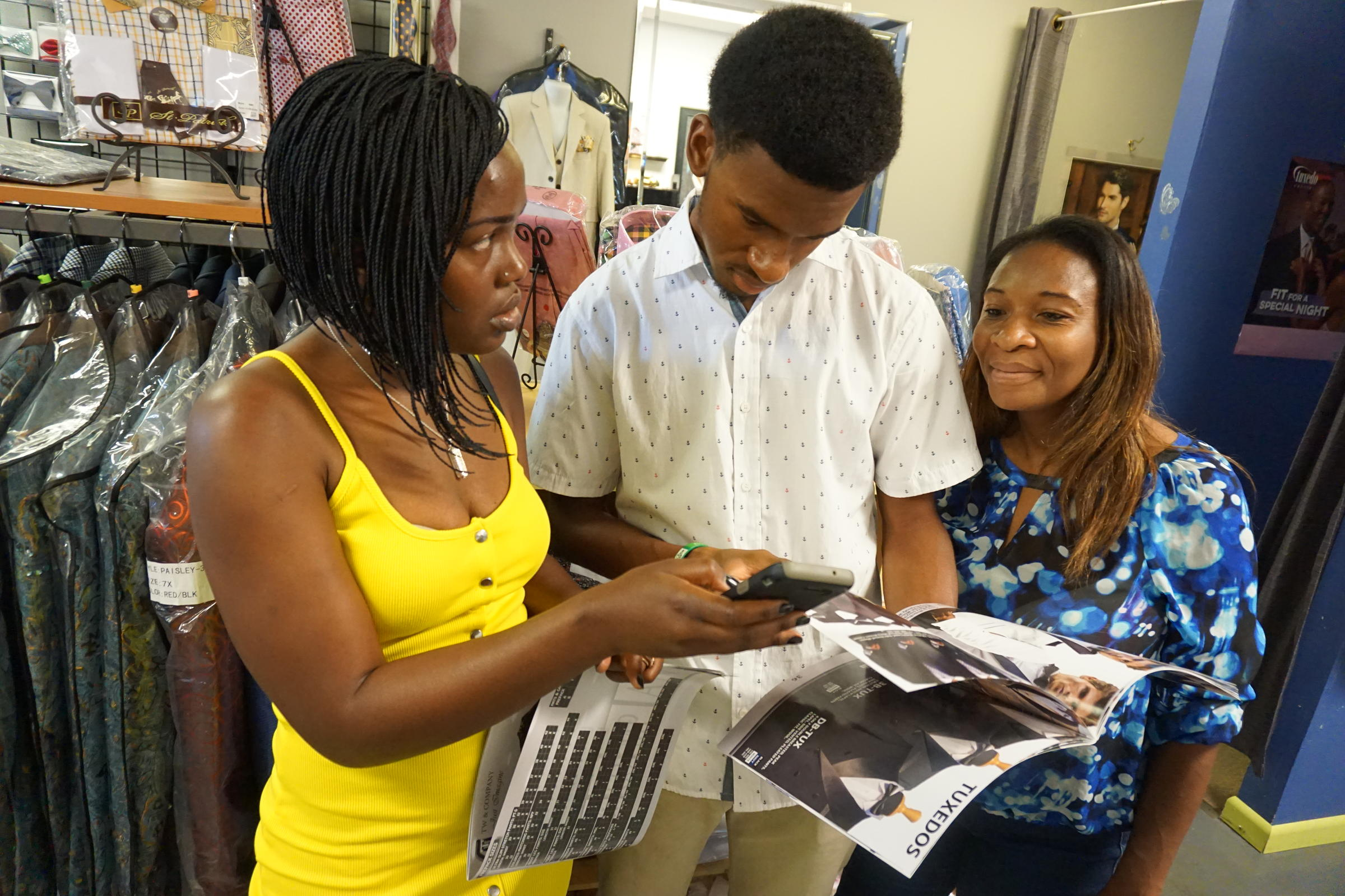 6d9501f97 Sirena Saul,left, with Chrisitan Namphy and his mother shop for prom suits.