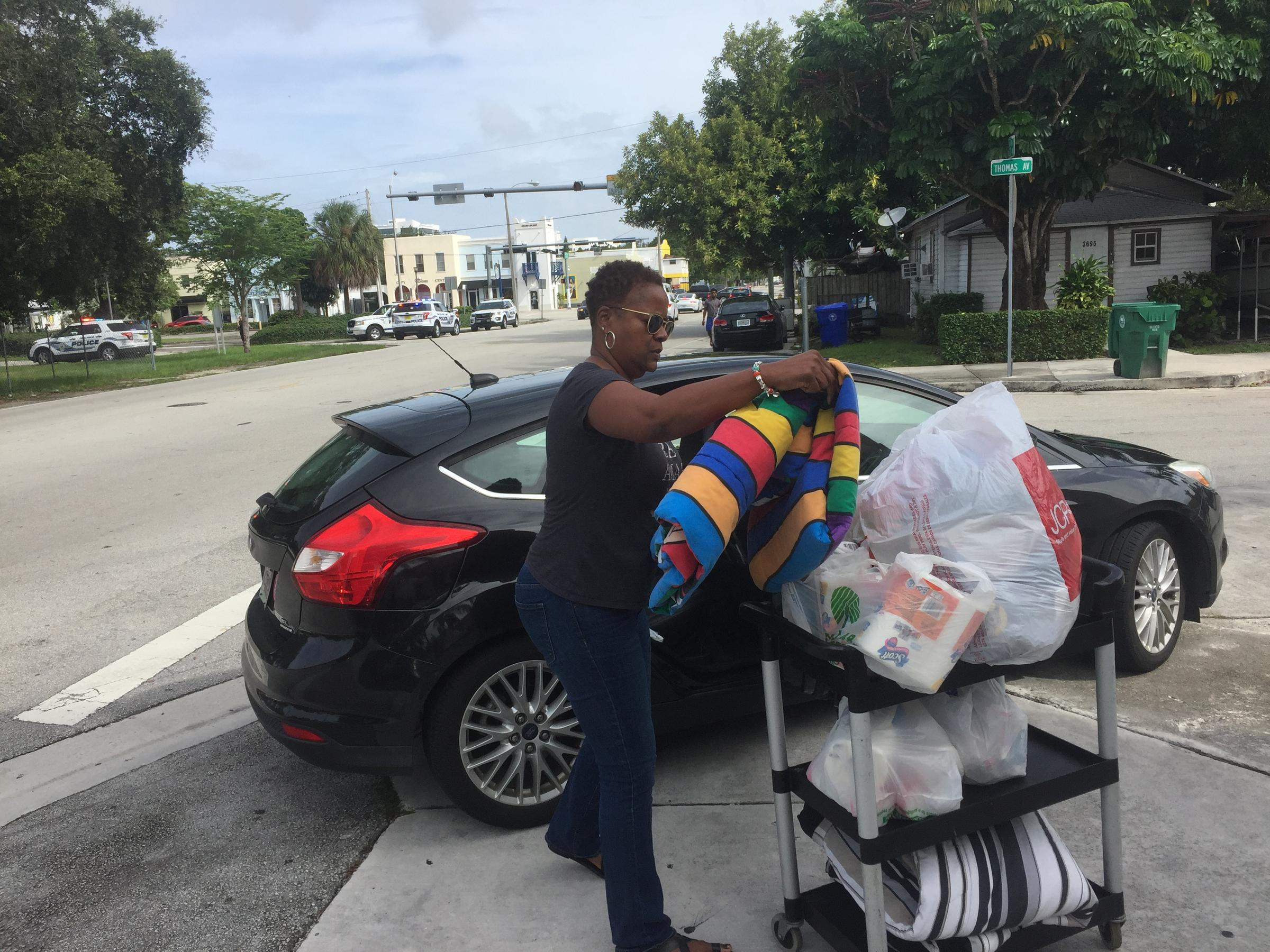 Greater St. Paul AME Church parishioner Pam Jennings unloads clothes and blankets for Hurricane Dorian victims in the Bahamas