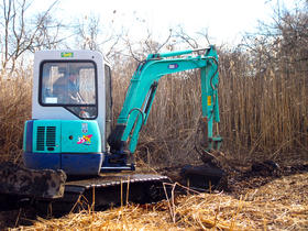 Al Gettman, the Rhode Island Department of Environmental Management mosquito abatement coordinator, operates a small excavator for a salt marsh adaptation project.