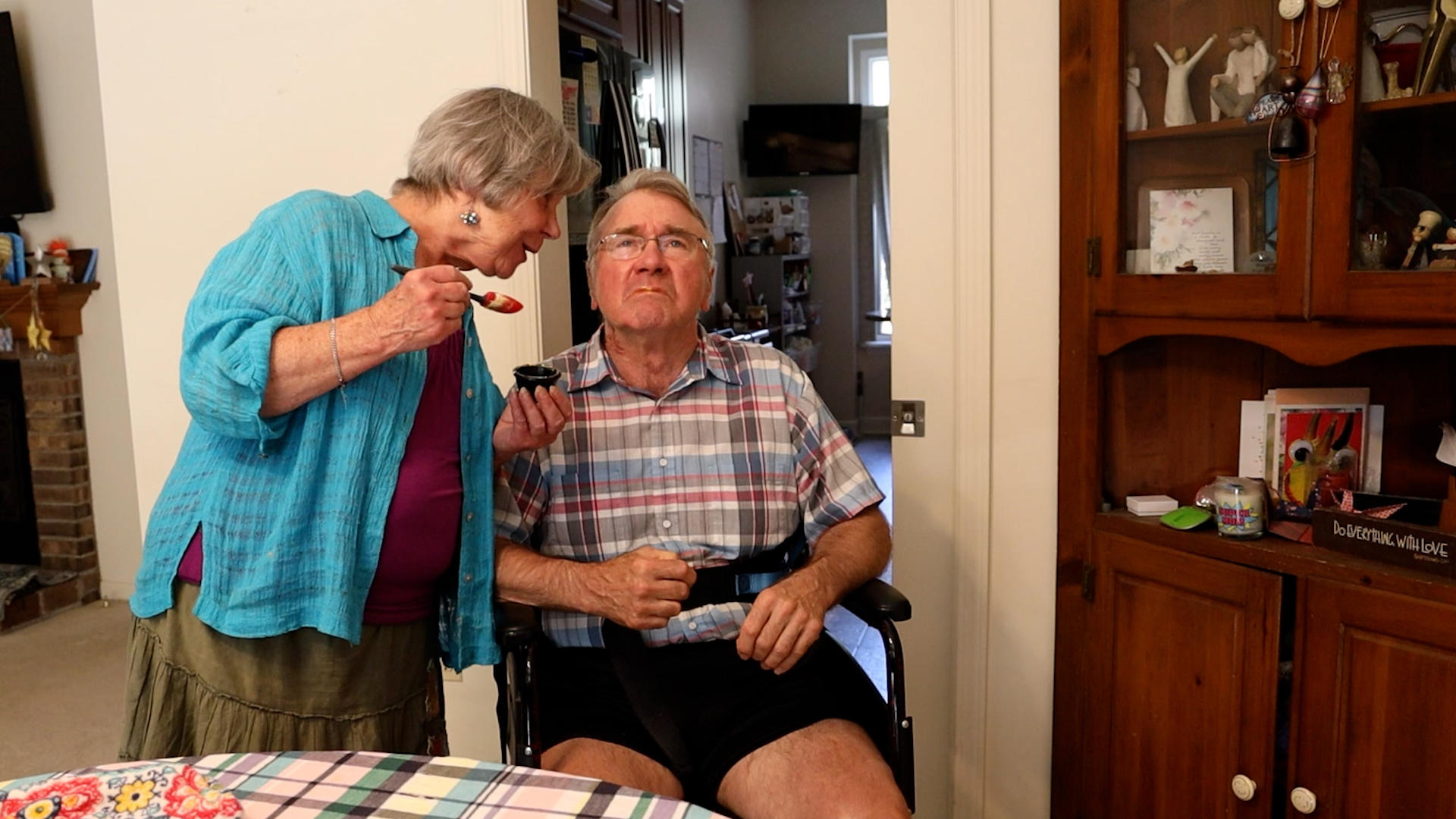 Caregiver taking care of her husband.