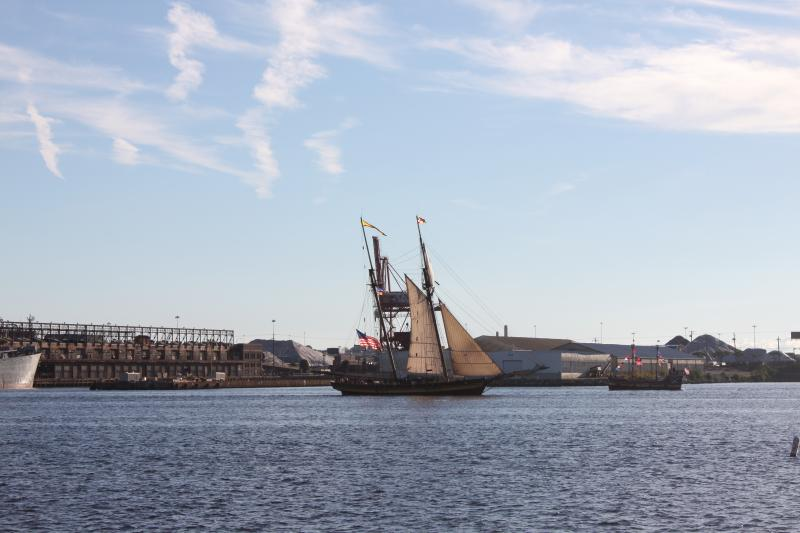 The tall ships drifted through the Harbor all morning.