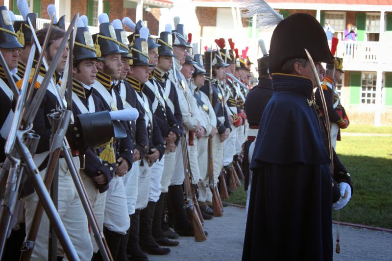 Fort McHenry was lined with men in historical garb, muskets in hand.